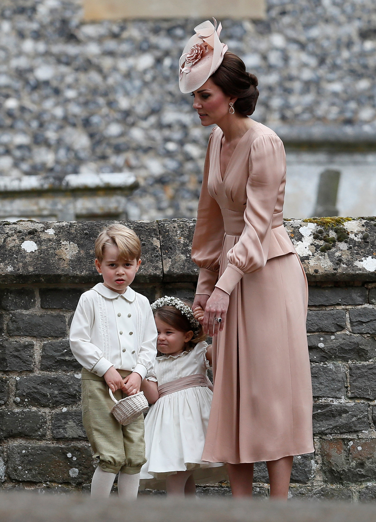 Catherine, Duchess of Cambridge, stands with Princess Charlotte and Prince George, who were flower boys and girls at the wedding of Pippa Middleton and James Matthews at St Mark's Church in Englefield, Britain May 20, 2017. REUTERS/Kirsty Wigglesworth/Pool