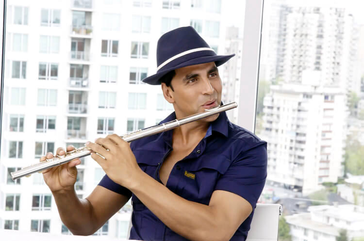 Akshay Kumar playing flute in a still from Thank You