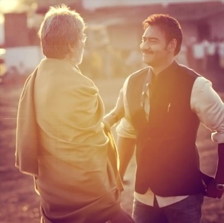 Amitabh Bachchan shares a candid moment with Ajay Devgn
