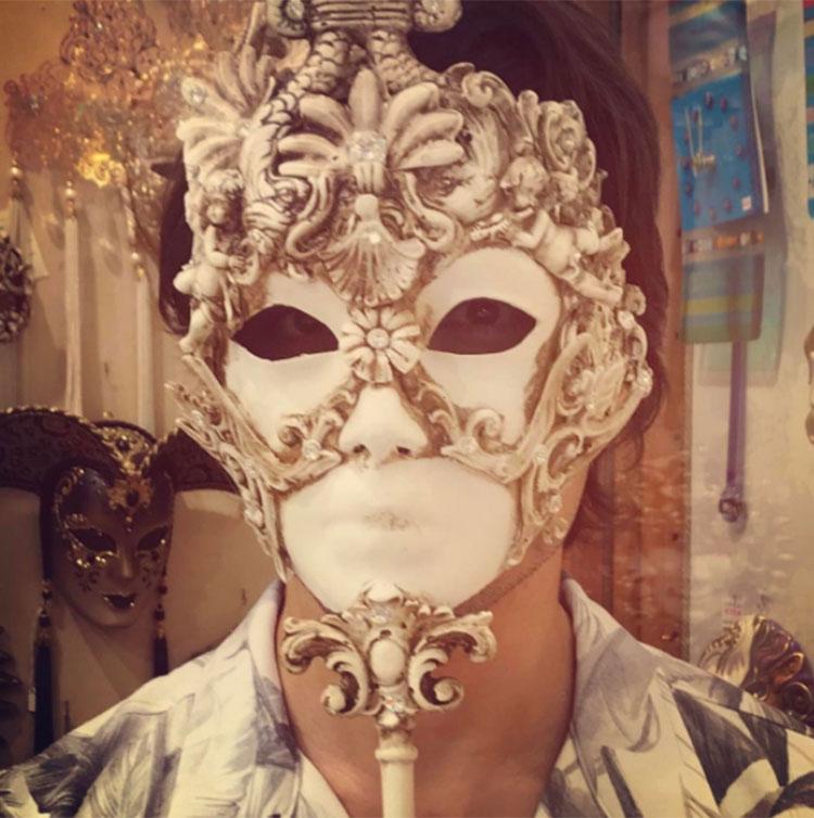 Ali Zafar tries on a mask at Venice