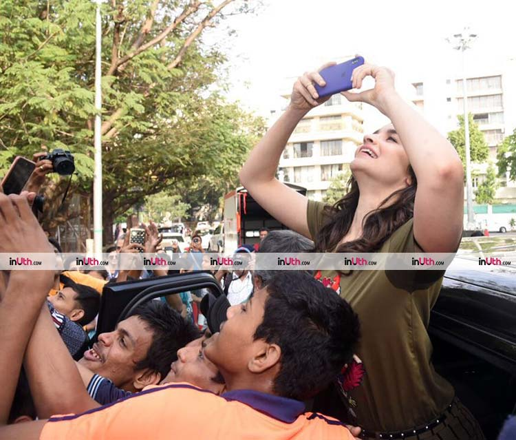 Alia Bhatt clicking some pics at an event