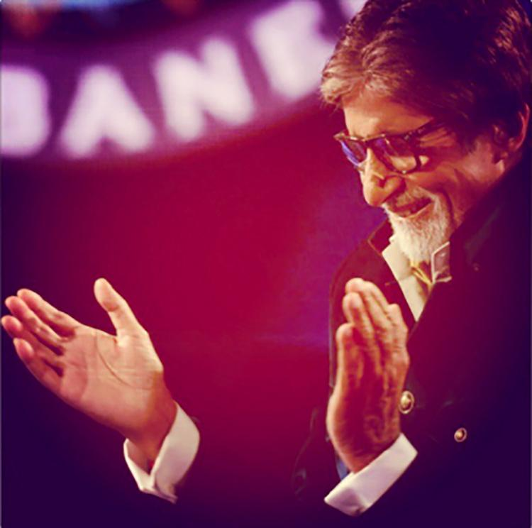 Amitabh Bachchan giving a hearty laugh in this candid pic