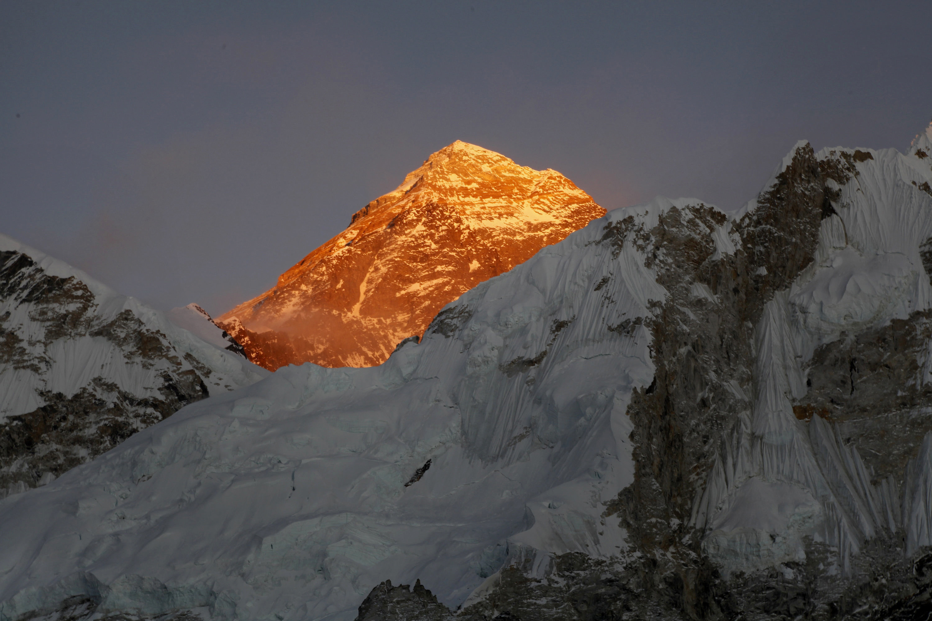 Mt. Everest is seen from the way to Kalapatthar in Nepal. An American climber has died near the summit of Mount Everest and an Indian climber is missing after heading down from the mountain following a successful ascent, expedition organizers said Sunday. (AP Photo/Tashi Sherpa, File)