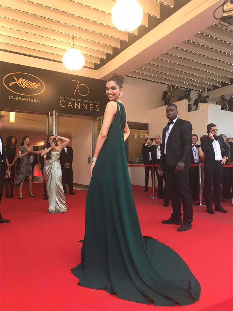 Deepika Padukone flashes a bright smile on the Cannes red carpet
