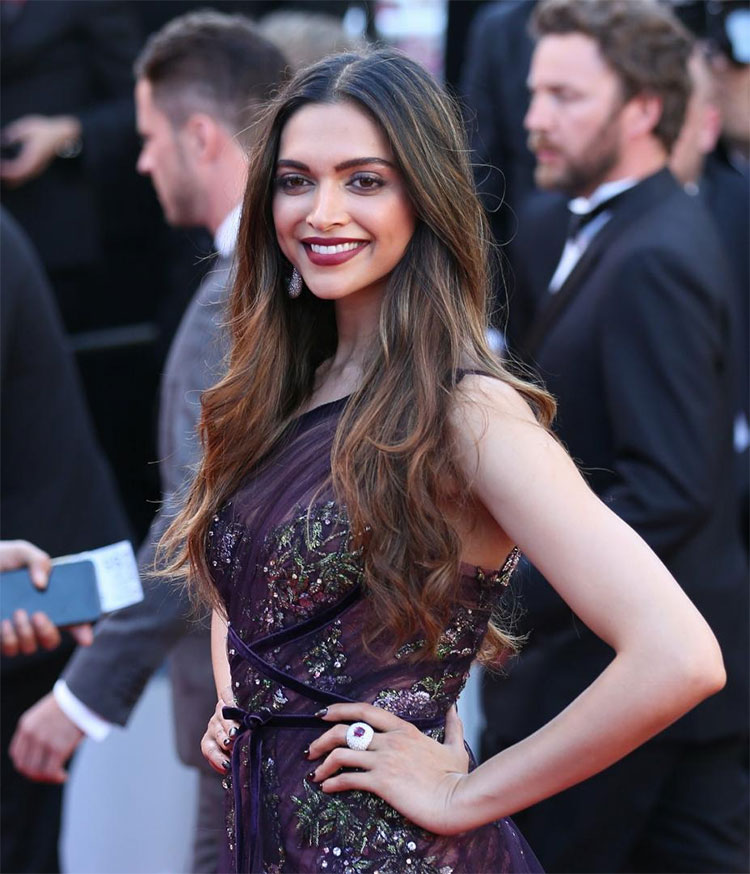 Deepika Padukone strikes a pose on the Cannes red carpet