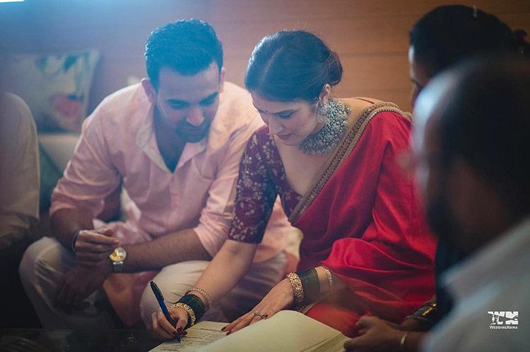 Sagarika Ghatge signing her wedding papers