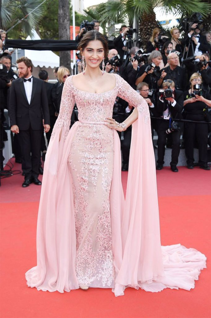 Sonam Kapoor flashing her charming smile at Cannes red carpet