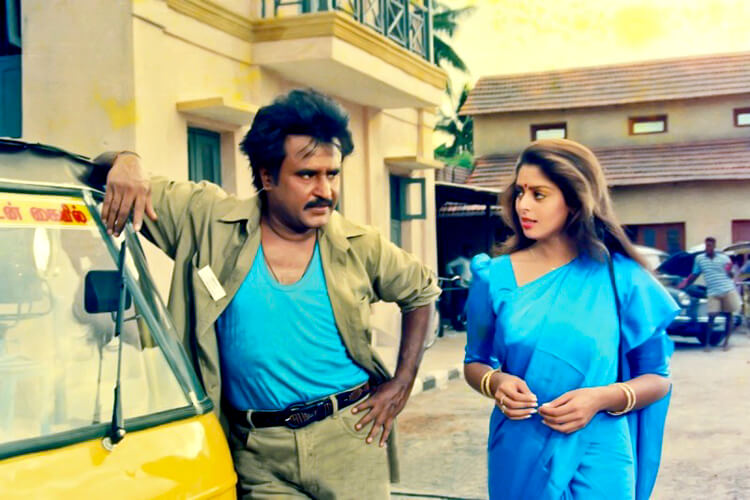 Rajinikanth with Nagma in a still from Baashha