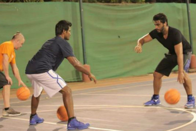 Arjun Kapoor practicing basketball