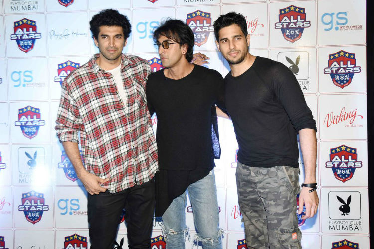 Sidharth Malhotra in a military print cargo along with Ranbir Kapoor and Aditya Roy Kapur