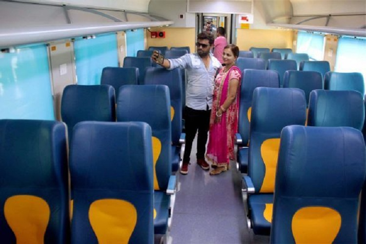 Couple takes selfie after boarding the Tejas Express/ PTI Photo