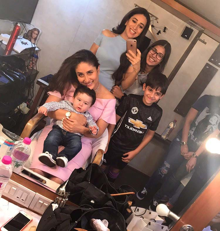 Taimur looks like a little doll in his mother Kareena's lap