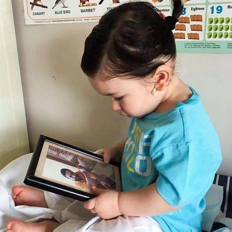 Taimur looks uber adorable with ponytail