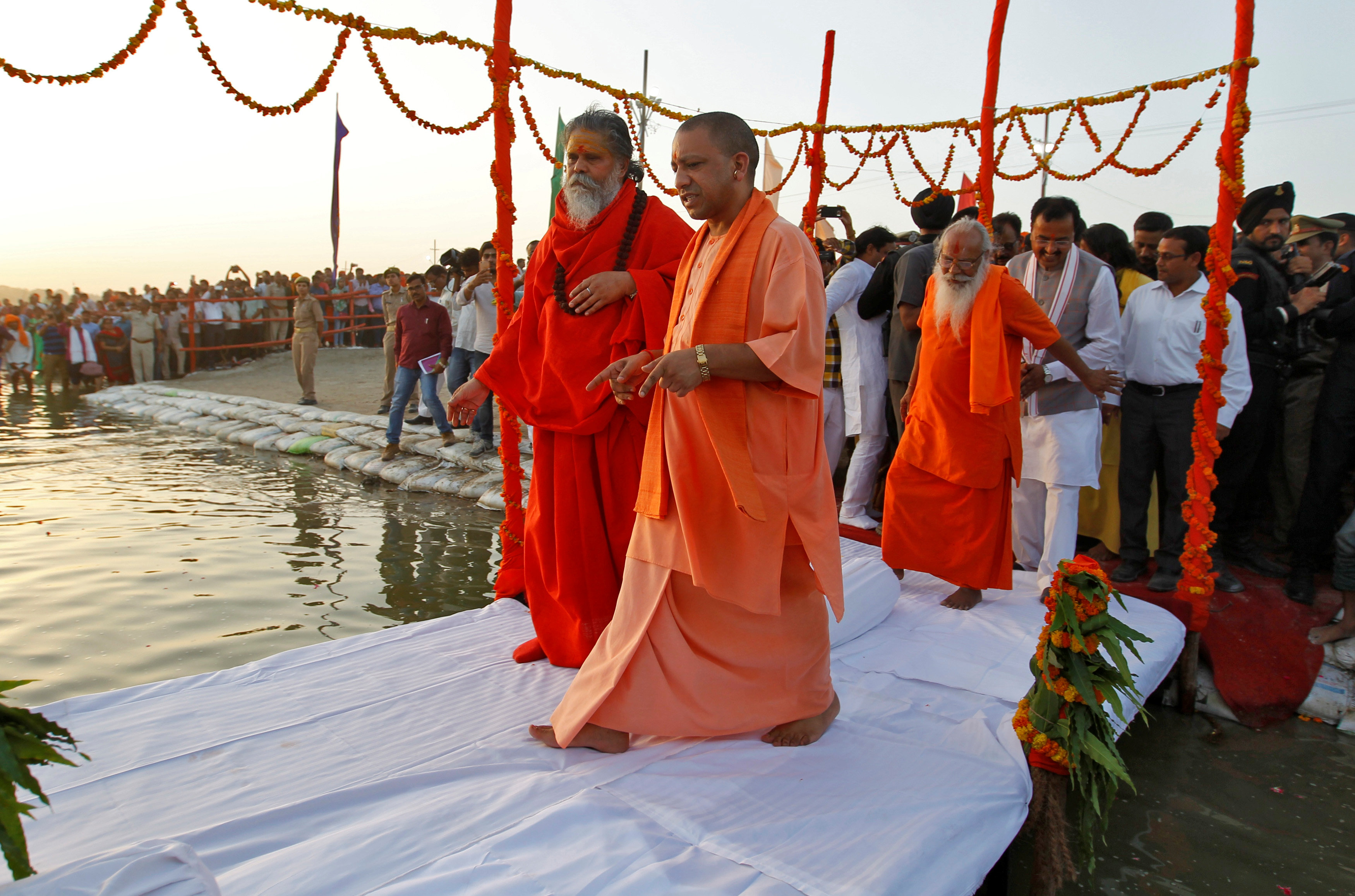 "Yogi Adityanath on the banks of the Ganges river to perform ""Aarti"" during his two-day long visit to Allahabad"