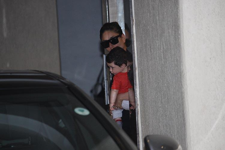 Cute bucket Taimur Khan playing peek-a-boo with the camera