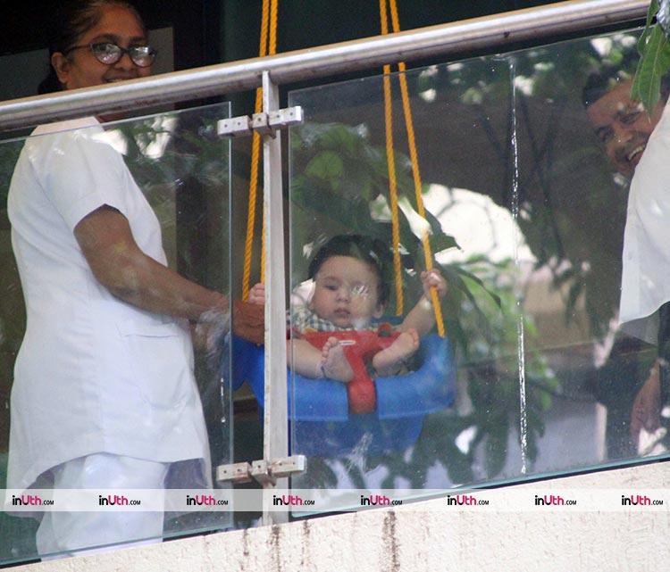 Just a cute photo of Taimur swinging