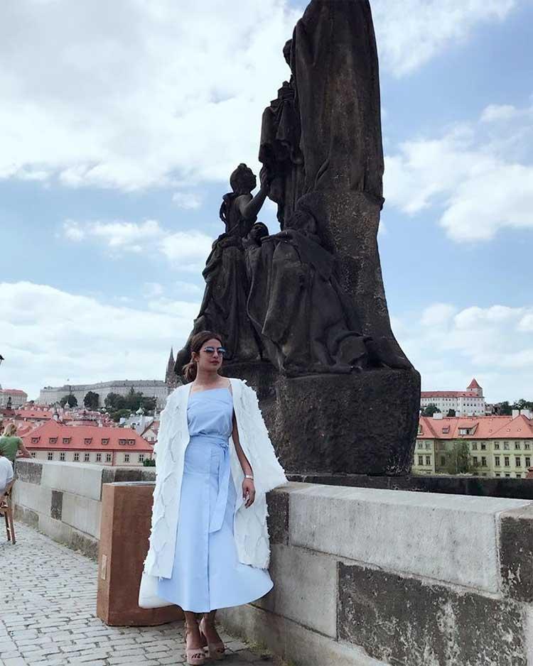 Priyanka Chopra posing at the Charles Bridge in Prague