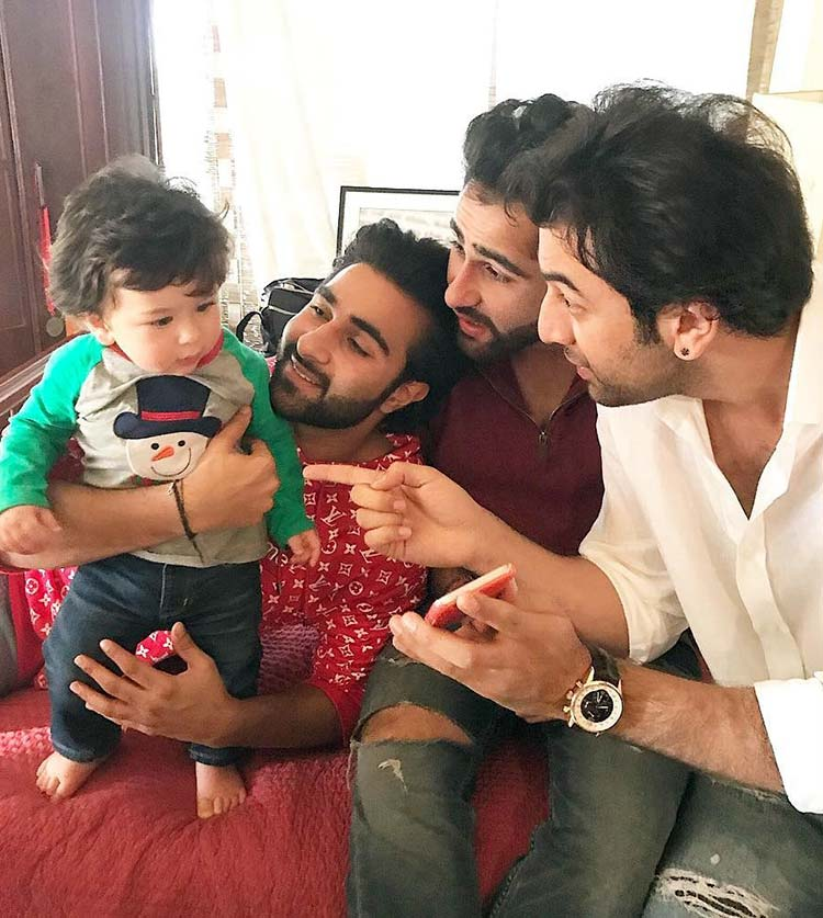 Taimur with his uncles at the Christmas party