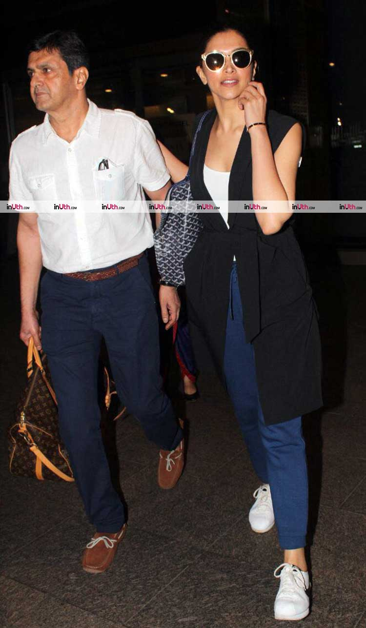 Deepika Padukone with Prakash Padukone at the airport