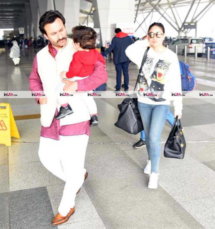 Saif Ali Khan and Taimur in conversation at the airport