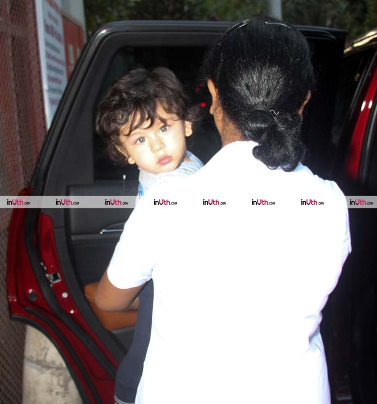 Taimur snapped peeping at the cameras on February 13, 2018