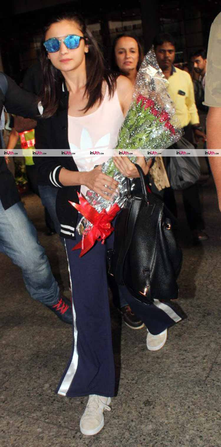 Alia Bhatt with a bouquet at the Mumbai airport