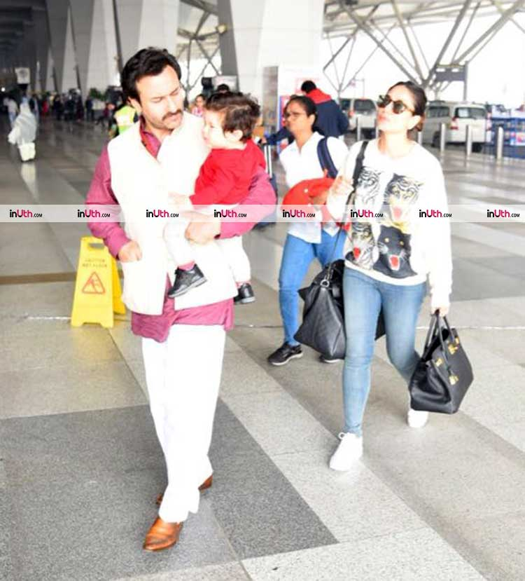 Taimur snapped in father Saif Ali Khan's arms at the airport