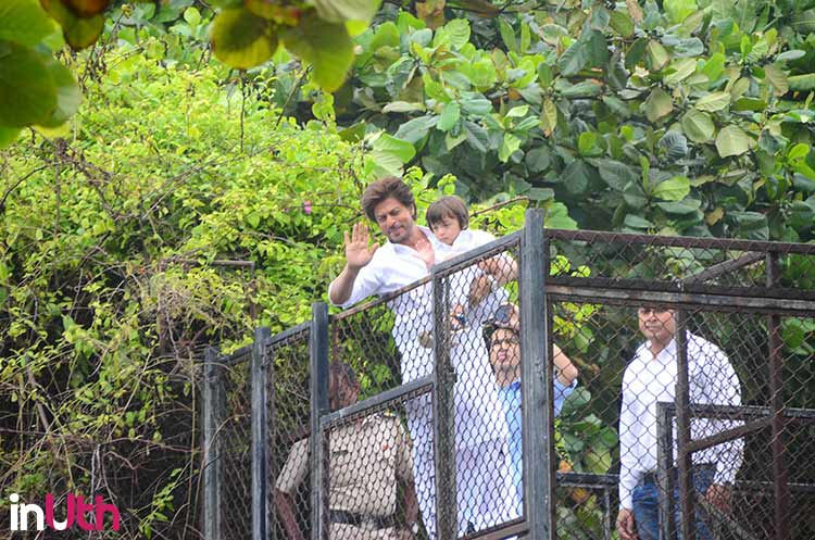 Shah Rukh Khan and AbRam wave to their fans