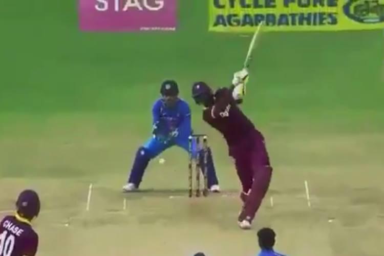 MS Dhoni pulls off SLOWEST stumping to take Jason Holder's wicket, Kuldeep Yadav applauds it | WatchVideo