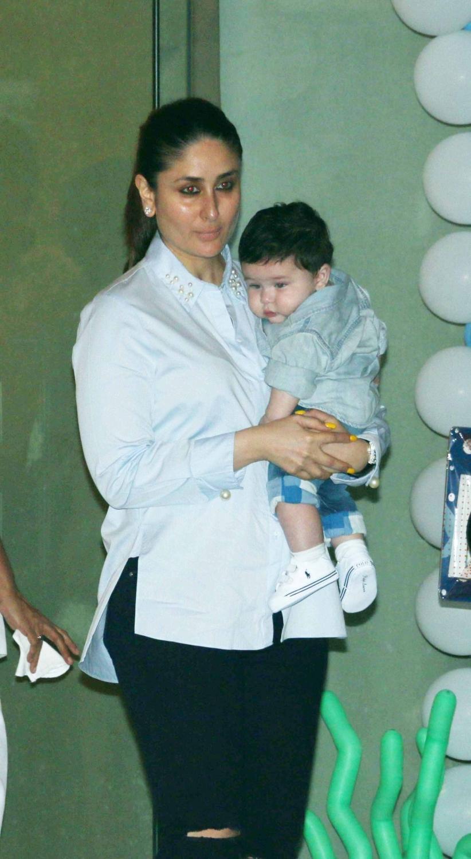 Mumbai: Actress Kareena Kapoor with her son Taimur Ali Khan during Tussar Kapoor son Laksshay`s first birthday party in Mumbai on June 1, 2017. (Photo: IANS)