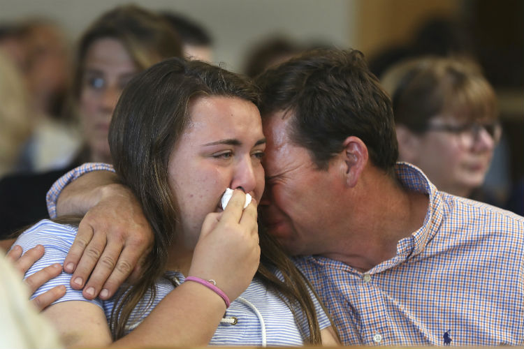 Conrad Roy, Jr. , father of Conrad Roy III, comforts his daughter Camdyn Roy
