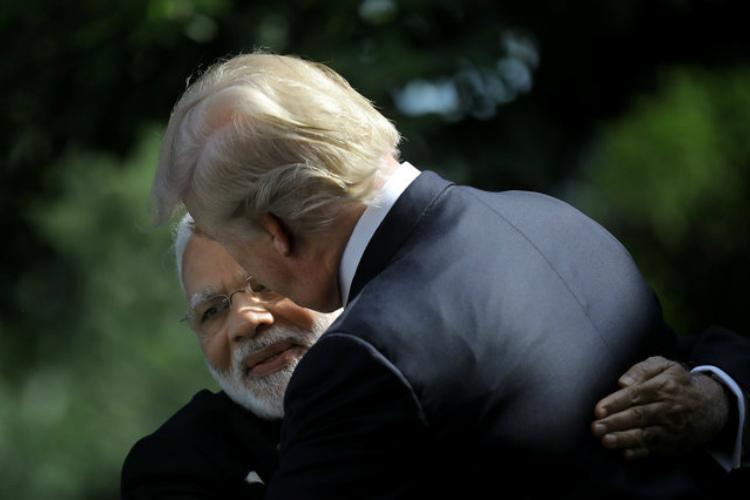 Narendra Modi hugs U.S. President Donald Trump