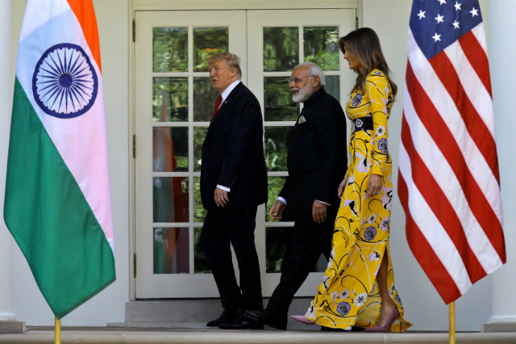 Donald Trump (L) and first lady Melania Trump walk with Indian Prime Minister Narendra Modi