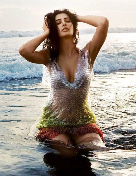 Nargis Fakhri on beach