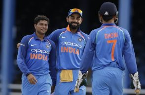 India's spin bowler Kuldeep Yadav, left, celebrates with captain Virat Kohli and wicket keeper MS Dhoni the dismissal of West Indies' captain Jason Holder during their second ODI cricket match at Queen's Park Oval in Port of Spain, Trinidad and Tobago, Sunday, June 25, 2017. (AP Photo/Ricardo Mazalan)
