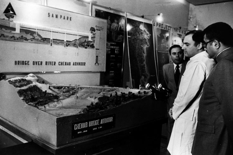 Rajiv Gandhi looking at model of Chenab Bridge at border silver jubilee, Arjun Singh is also seen in the picture. (Express archive photo)