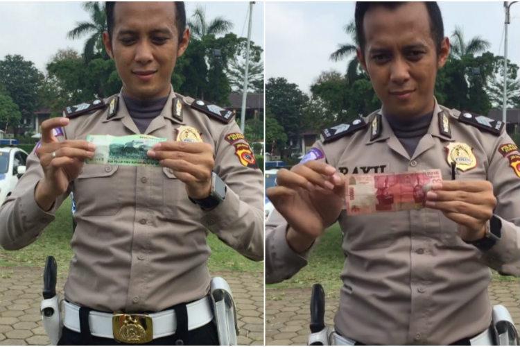 Indonesian policeman performs magic