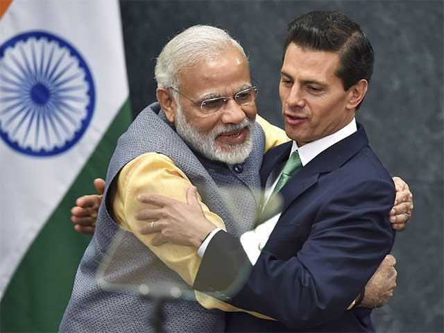 PM Modi hugging Mexican President Enrique Pena Nieto