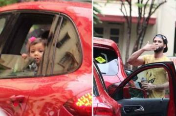 Photos of Misha waiting for daddy Shahid Kapoor outside his gym