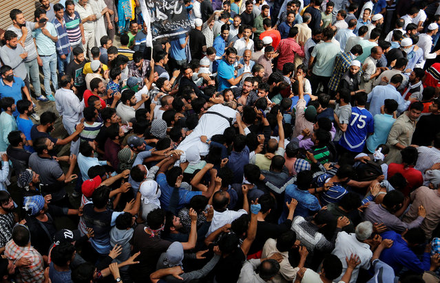 People carry the body of Sajad Ahmad Gilkar, who according to local media was killed in a gun battle with Indian security forces at the Radbugh Village of Budgam District, during his funeral in Srinagar July 12, 2017. (Photo: Reuters/Danish Ismail)