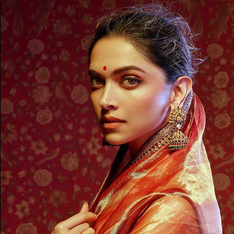 Deepika Padukone in a coromandel red saree by Sabyasachi