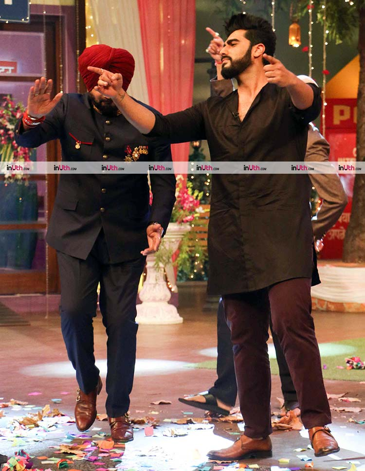 Arjun Kapoor performing with Navjot Singh Sidhu on The Kapil Sharma Show
