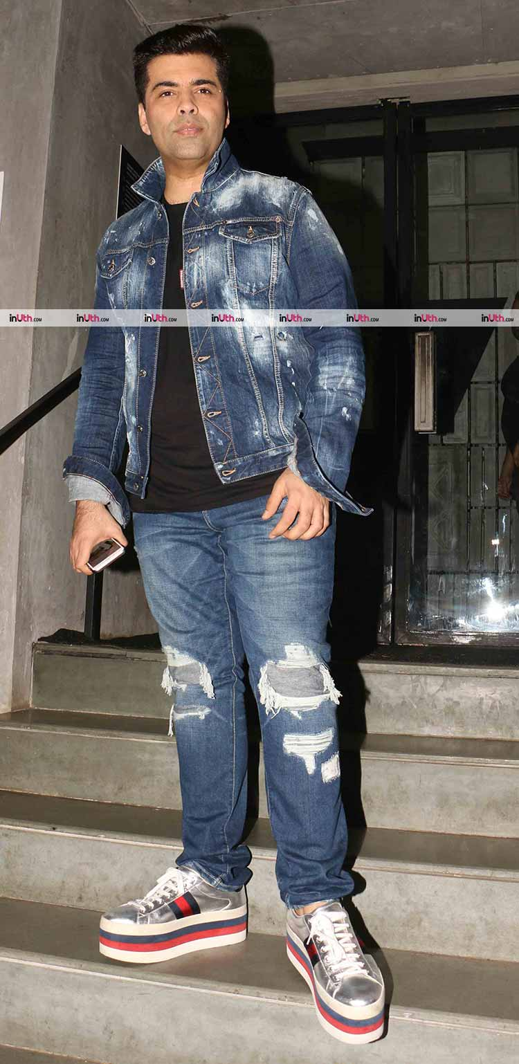 Karan Johar flaunts a denim on denim look