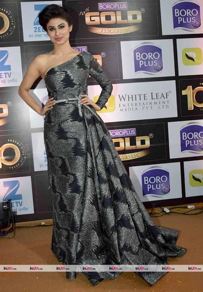 Mouni Roy posing on the Zee Gold Awards red carpet