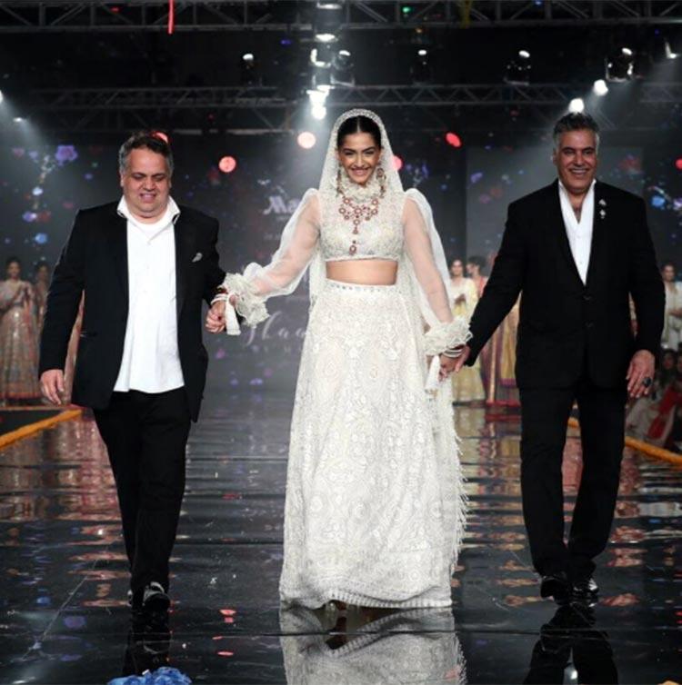 Sonam Kapoor walking the ramp with Abu Jani and Sandeep Khosla