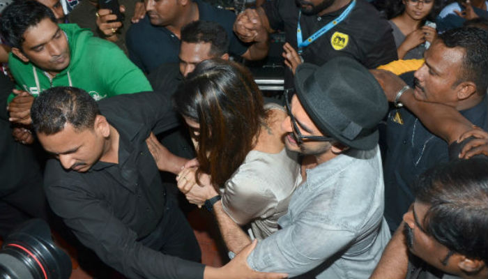 Ranveer Singh protecting Deepika Padukone in the crowd