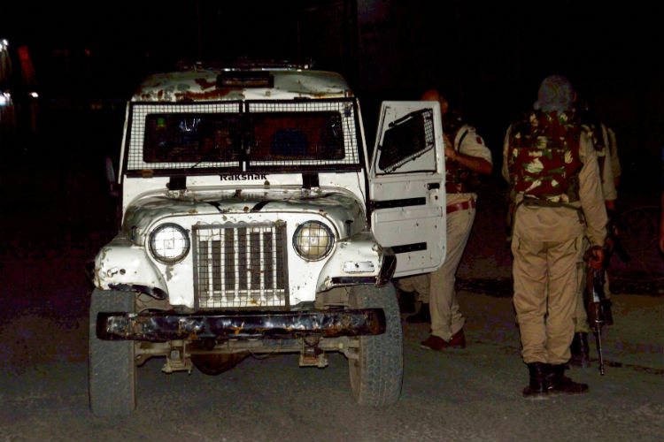Security person stand guard after militants opened fire on the Amarnath Yatra (Photo: PTI)