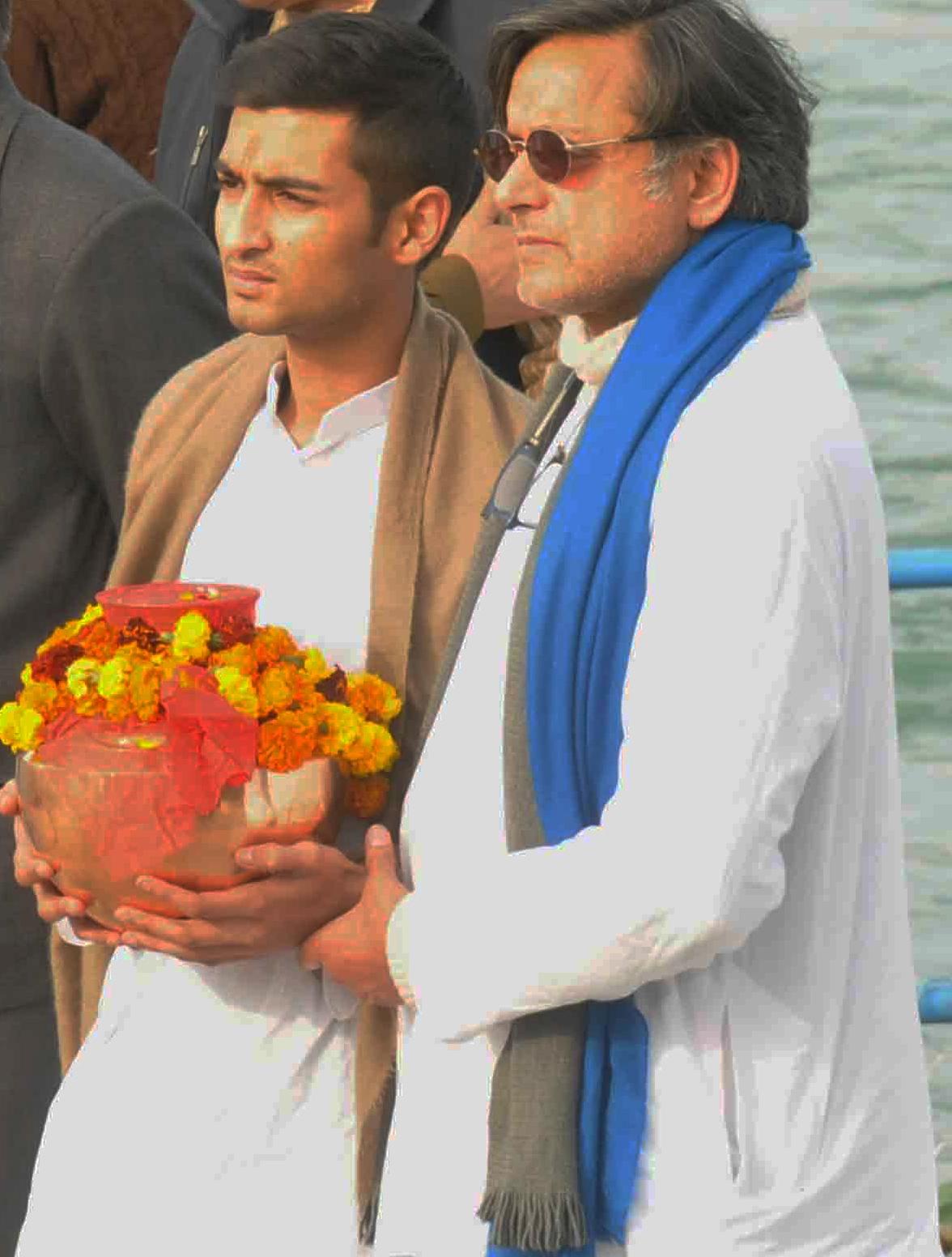 Sunanda Pushkar's husband and Union minister Shashi Tharoor and son Shiv Menon at Haridwar on Monday. 200114. Express archive Photo.