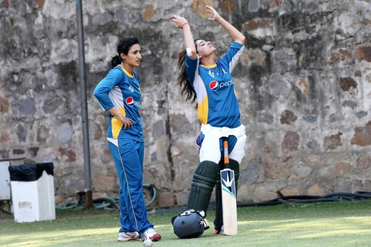 Pakistan captain Sana Mir (R) adjusts her hair during a training session, a day before their World Cup T-20 match aagainst India, at Ferozeshah Kotla stadium in New Delhi on March 18th 2016. Express photo by Ravi Kanojia.