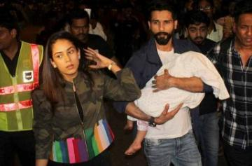 Shahid Kapoor and Mira Rajput leave for IIFA 2017 with Misha photo